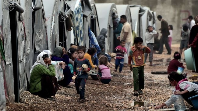 USA and EU accepting small numbers of Syrian refugeesimage