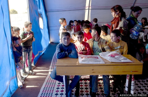 Syrian Refugee Kids Have To Beat Illiteracy by School Housed In A Tentimage