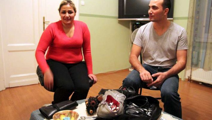 Syrian Couple Pay Back To Hungary By Giving Free Haircutsimage