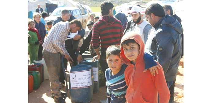 Qatar Charity distributes heating fuel in Syrian campsimage