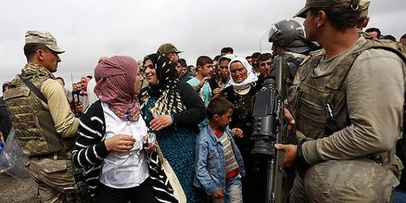Female Syrian refugees would rather go to Syria than refugee campsimage