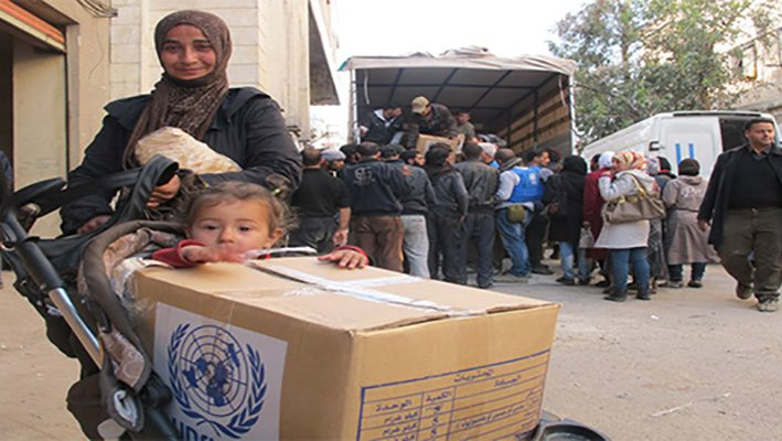 Humanitarian Supplies From UN Reach To Syrians Who In Needimage