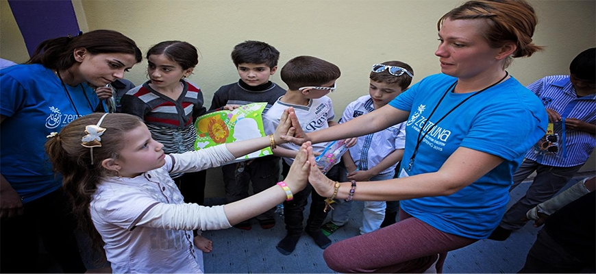 From Tustin to Turkey: Local woman teaches yoga to Syrian refugeesimage