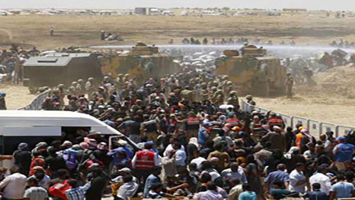 2000 additional refugees crossing into Turkey due to the fighting in northern Syriaimage