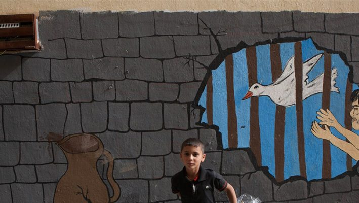 Syrian children paint life in Saddam's Kurdistan prisonimage