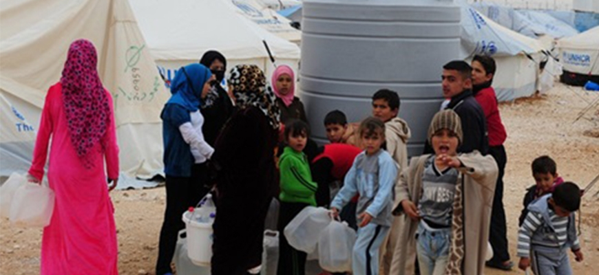 100 million pounds as a new British aid for Syrian refugees in Ammanimage