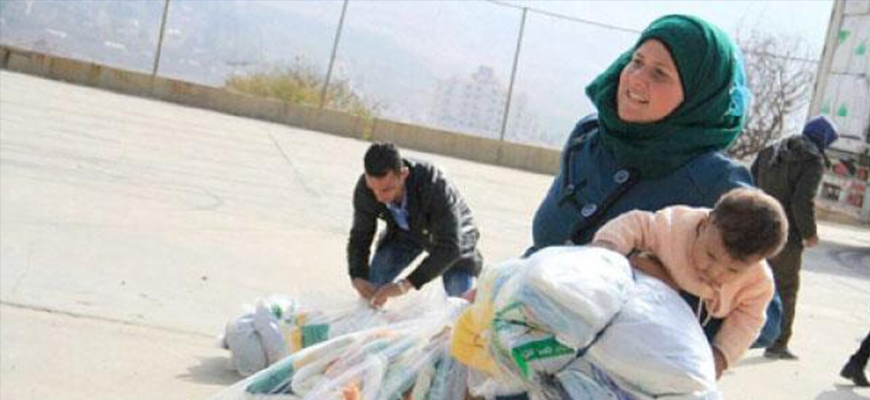 Saudi Arabia distributes winter clothing to Syrians in Lebanonimage